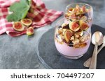 two glasses of fruit yogurt... | Shutterstock . vector #704497207