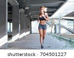 young female athlete running... | Shutterstock . vector #704501227