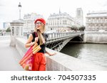 young stylish woman in red cap... | Shutterstock . vector #704507335