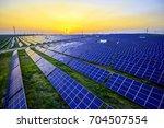 sunset solar photovoltaic | Shutterstock . vector #704507554