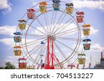 colorful ferris wheel at a fair | Shutterstock . vector #704513227