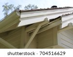 Small photo of Close up of eaves and overhangs and fascia boards on early 20th century house built from a kit. The notched ends alert home builder which board end goes toward edge.