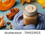 warm pumpkin spiced latte or... | Shutterstock . vector #704523925