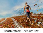 a vital woman runs through a... | Shutterstock . vector #704524729