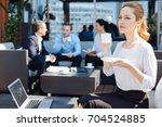 attractive blonde woman... | Shutterstock . vector #704524885