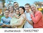 big happy family standing...   Shutterstock . vector #704527987