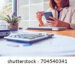 asian young business woman... | Shutterstock . vector #704540341
