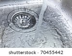 water flowing down the kitchen sink - stock photo