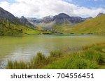 lake of tignes  tignes le lac  ... | Shutterstock . vector #704556451