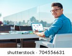 stylish freelancer looking into ... | Shutterstock . vector #704556631