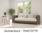 idea of white room with sofa... | Shutterstock . vector #704573779