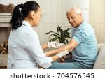 skillful medical worker doing... | Shutterstock . vector #704576545