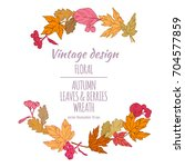 wreath of autumn leaves and... | Shutterstock .eps vector #704577859