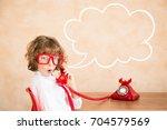 child pretend to be businessman.... | Shutterstock . vector #704579569
