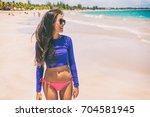 beach rashguard bikini woman... | Shutterstock . vector #704581945