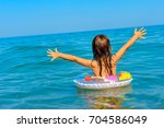 happy little girl swims in the... | Shutterstock . vector #704586049