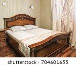 interior of a hotel bedroom | Shutterstock . vector #704601655