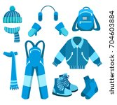 blue winter clothes collection... | Shutterstock .eps vector #704603884