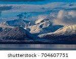 arctic sunset near pond inlet ... | Shutterstock . vector #704607751