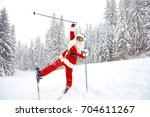 santa claus skiing in the...   Shutterstock . vector #704611267
