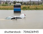 sedan car swamped by flood... | Shutterstock . vector #704626945