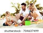 happy family is enjoying beach... | Shutterstock . vector #704637499