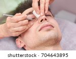 cosmetician cleaning face close ...