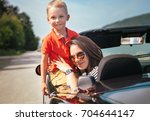 mother and little son sitting... | Shutterstock . vector #704644147