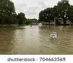 Hurricane Harvey 2017, flooding in Spring Texas, a couple miles north of Houston. Speed limit sign almost completely submerged.