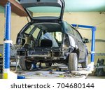 car in a body shop | Shutterstock . vector #704680144