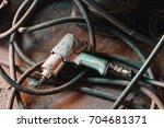 wrench gun in the car repair... | Shutterstock . vector #704681371
