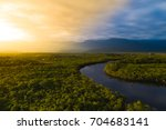 aerial view of a rainforest in... | Shutterstock . vector #704683141