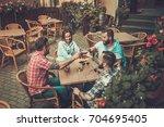 good old friends drinking beer...   Shutterstock . vector #704695405