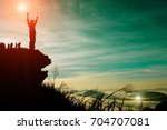 silhouette of man standing on... | Shutterstock . vector #704707081