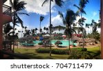 Small photo of Hotel Punta Cana Princes, Dominican Republic - July 08, 2016: Swimming pool in tropical hotel Punta Cana Princess set on Arena Blanca Beach, this is relaxed, adults-only all-inclusive resort.
