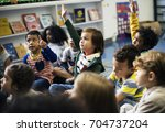 kindergarten students sitting... | Shutterstock . vector #704737204