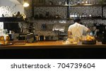 male barista preparing hot... | Shutterstock . vector #704739604