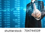 investment concept hand with... | Shutterstock . vector #704744539