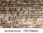 vintage brick wall in thailand  | Shutterstock . vector #704748601