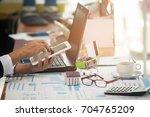 a business woman analyzing... | Shutterstock . vector #704765209