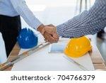 businessmen handshake for make... | Shutterstock . vector #704766379