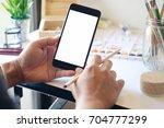 designer or artist holding... | Shutterstock . vector #704777299