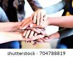 team teamwork join hands... | Shutterstock . vector #704788819