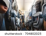 cabin aisle in airplane   Shutterstock . vector #704802025