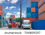 forklift handling container box ... | Shutterstock . vector #704809207