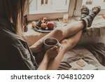 cozy home. woman with cup of...