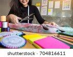 hands notch tailor tailor's... | Shutterstock . vector #704816611