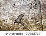 hex tip on oil smeared metal - stock photo