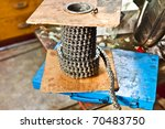 motorcycle chain on a roll - stock photo
