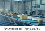 parcels are moving on belt... | Shutterstock . vector #704838757